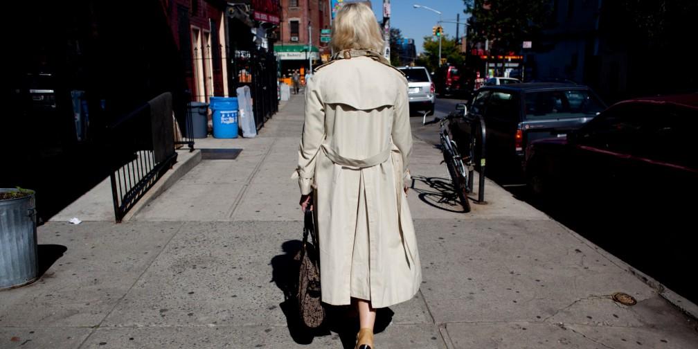 o-woman-walking-on-a-sidewalk-facebook